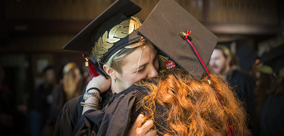 Reed College students embrace during commencement