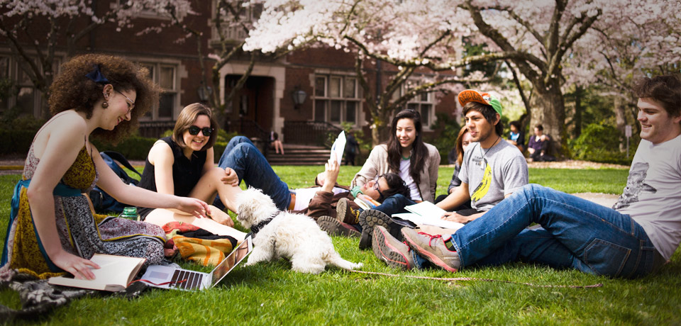 Reed College students enjoying spring in Eliot Circle among the cherry blossom trees
