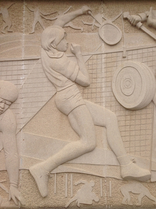 Bas-relief of badminton player.