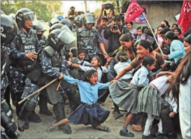 Mechi Mahakali School student (center) protests the destruction of her school and home.